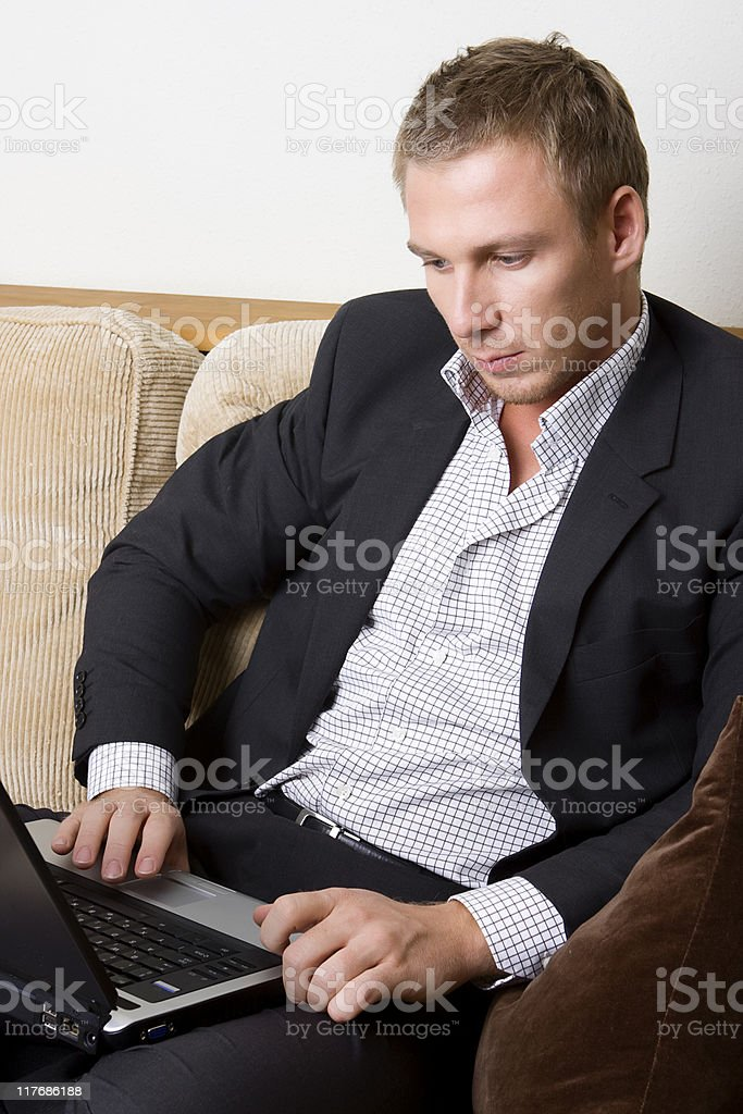 Young man relaxing with laptop royalty-free stock photo