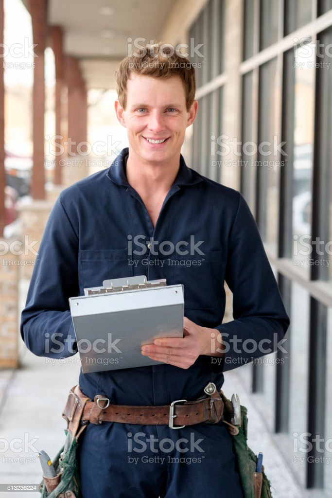 Young Man Repairman stock photo