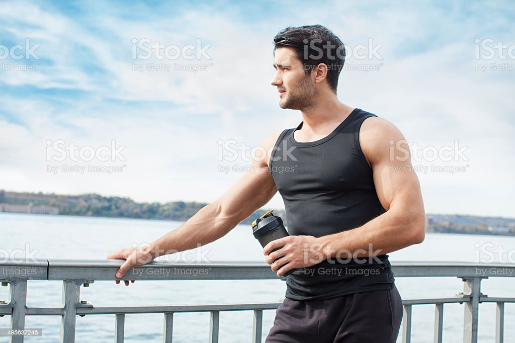 Young man resting after outdoor exercise stock photo