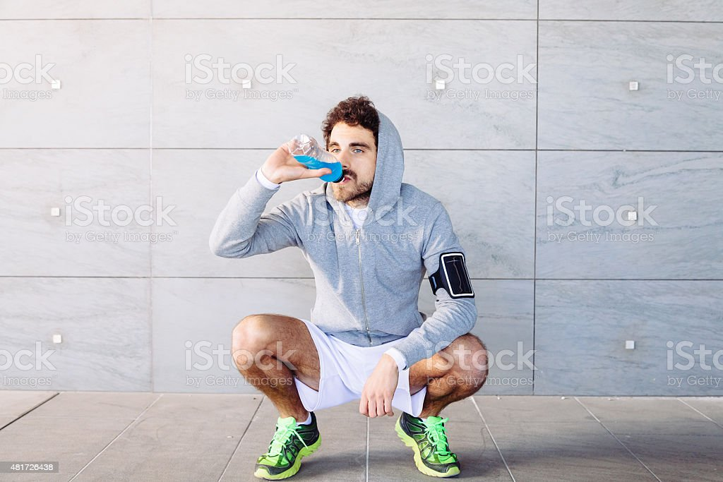 Young man resting on a run stock photo