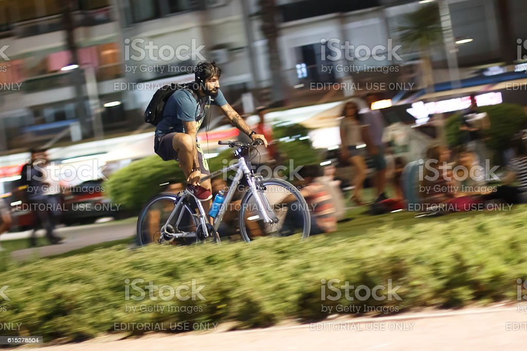 Young man rides bicycle stock photo