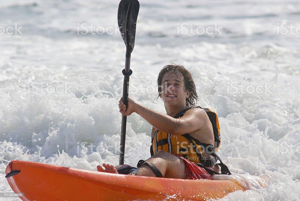 Young Man Rides Kayak to Shore royalty-free stock photo