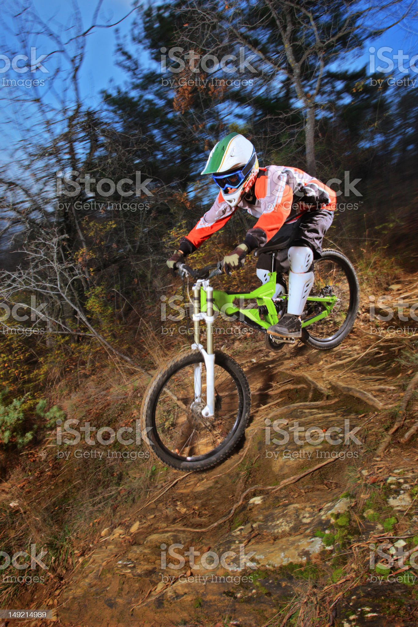 Young man riding a mountain bike downhill style royalty-free stock photo