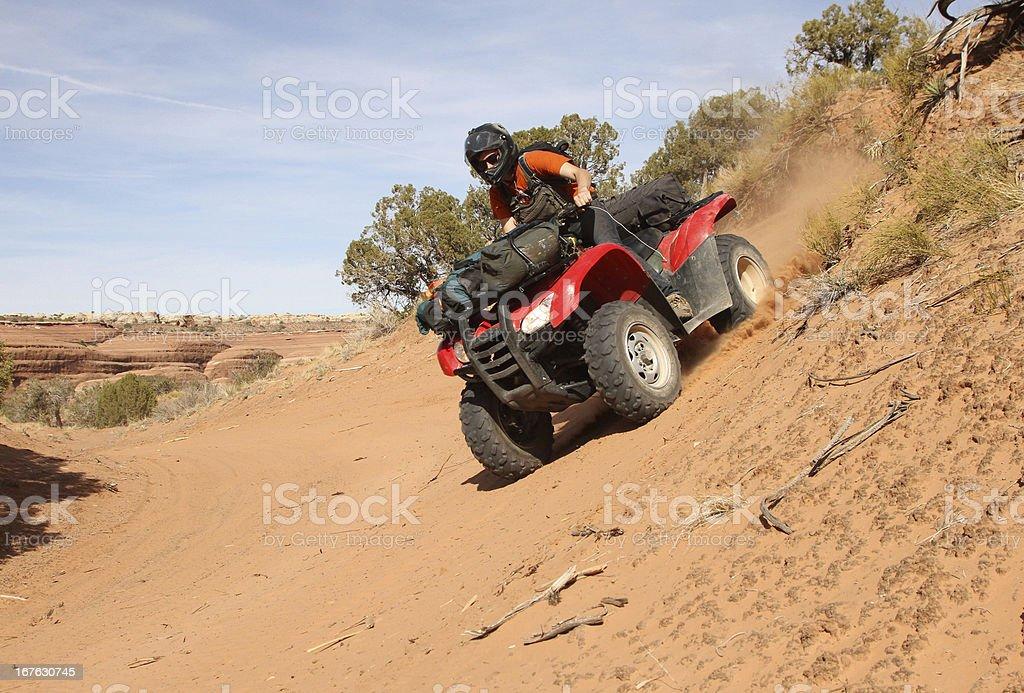 Young man riding  an ATV. royalty-free stock photo