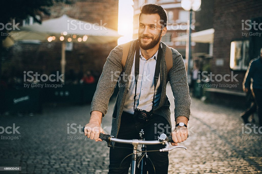 Young man riding bicycle stock photo