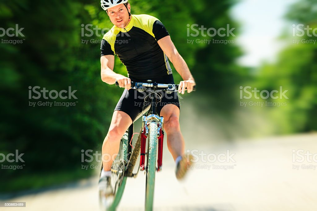 young man riding his mountain bike stock photo