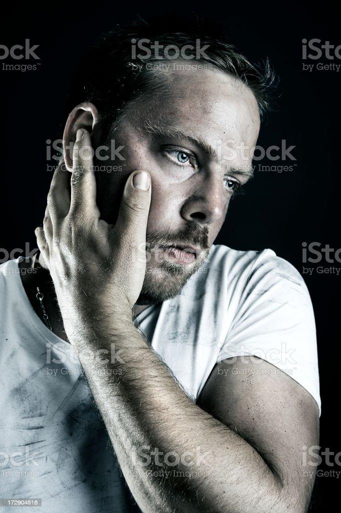 Young Man Rubbing Head stock photo