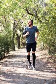 Young man running at park