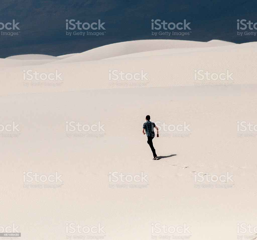 Young Man Running at White Sands National Monument stock photo