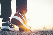 young man running sport feet on trail healthy lifestyle