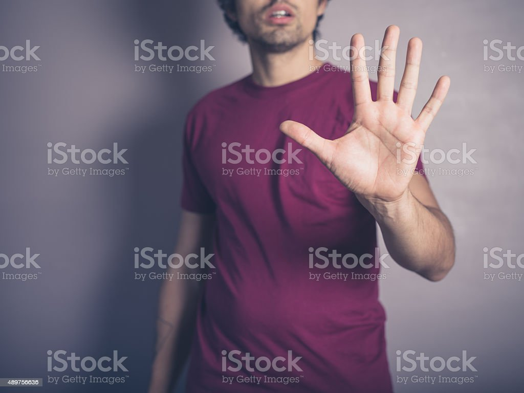 Young man saying stop stock photo