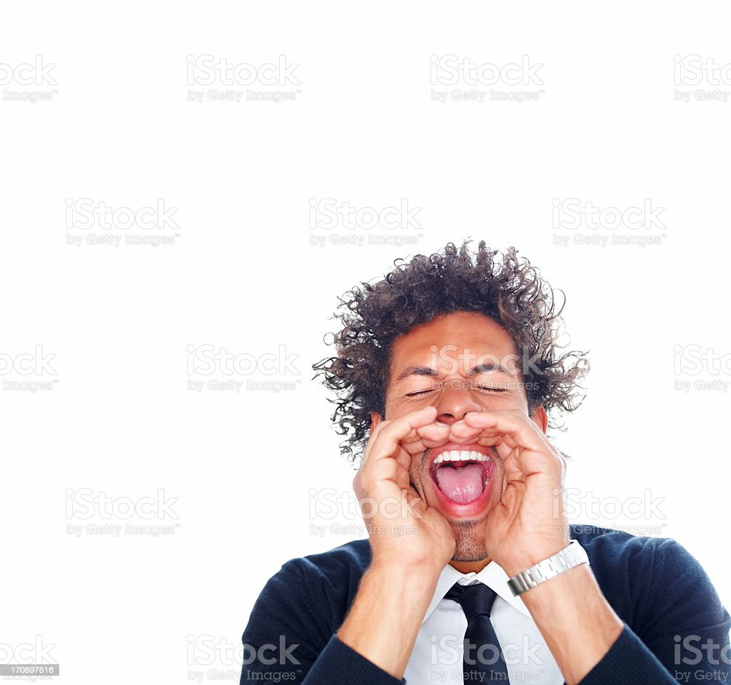 Young man screaming out loud on a white background stock photo
