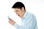 Young man screaming to mobile phone