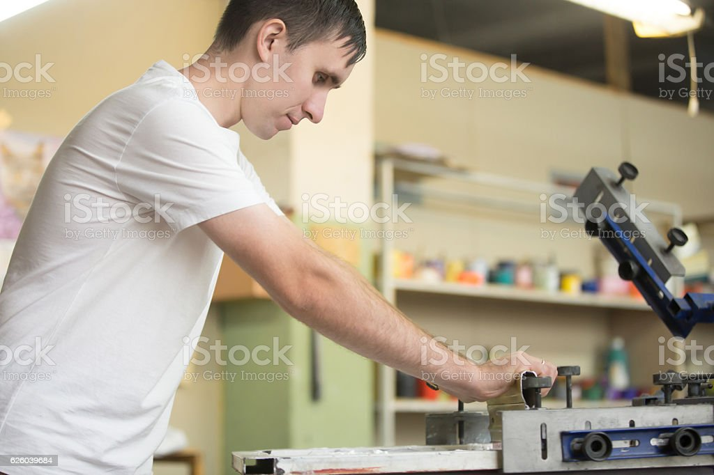 Young man screen printing stock photo