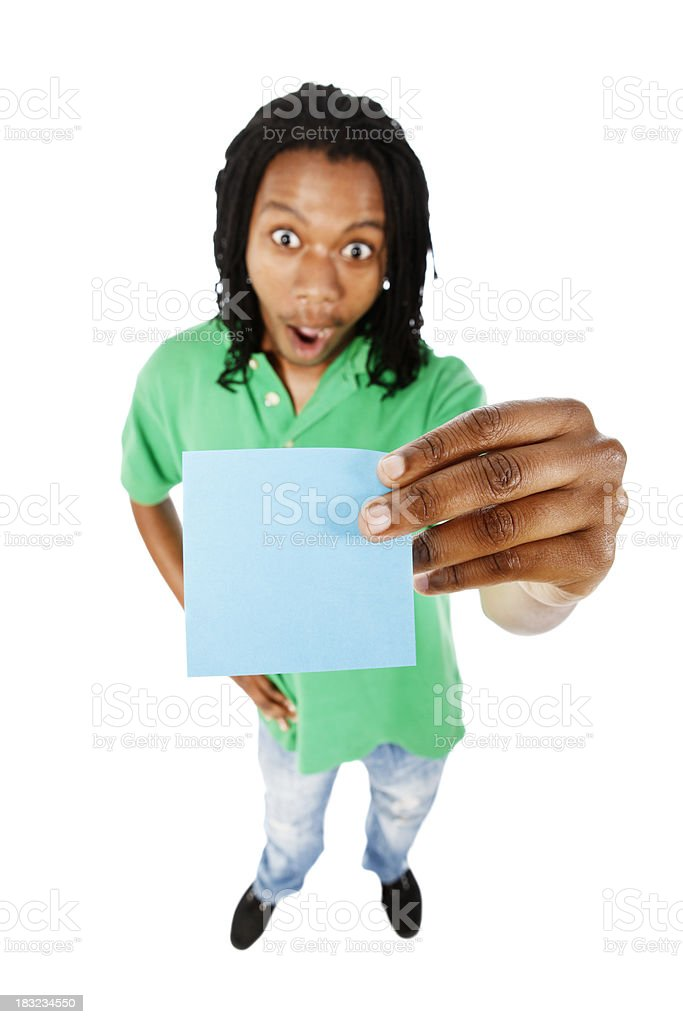 Young man seems amazed by blank blue note he holds stock photo