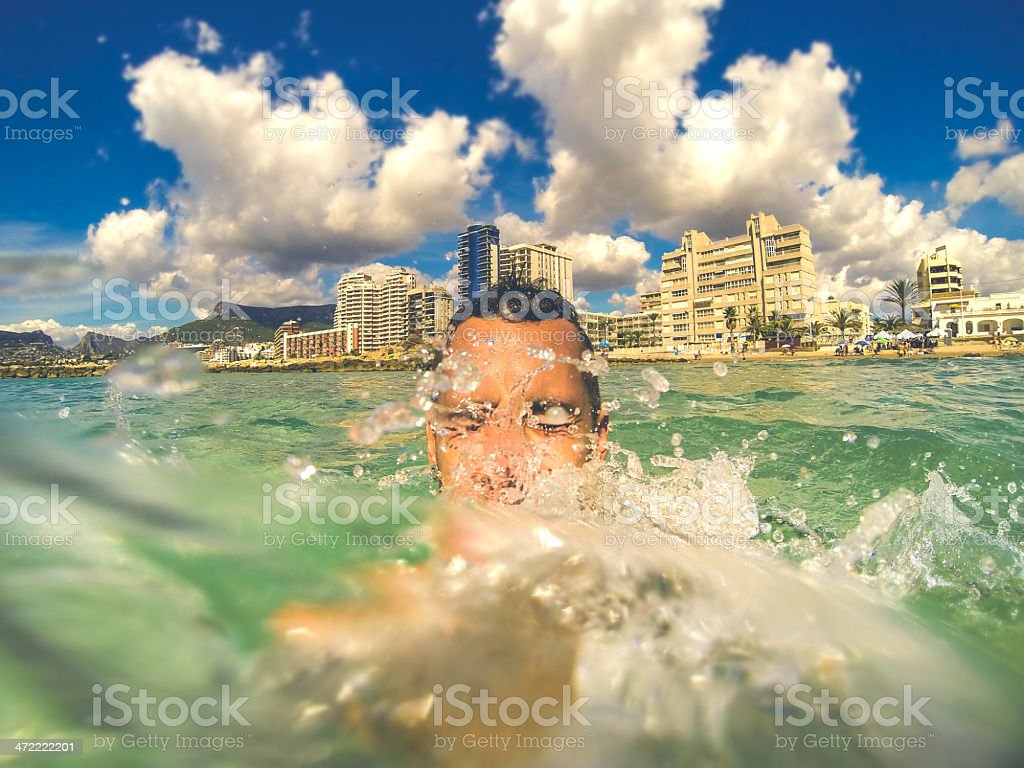 Young man self portrait in the seawater stock photo