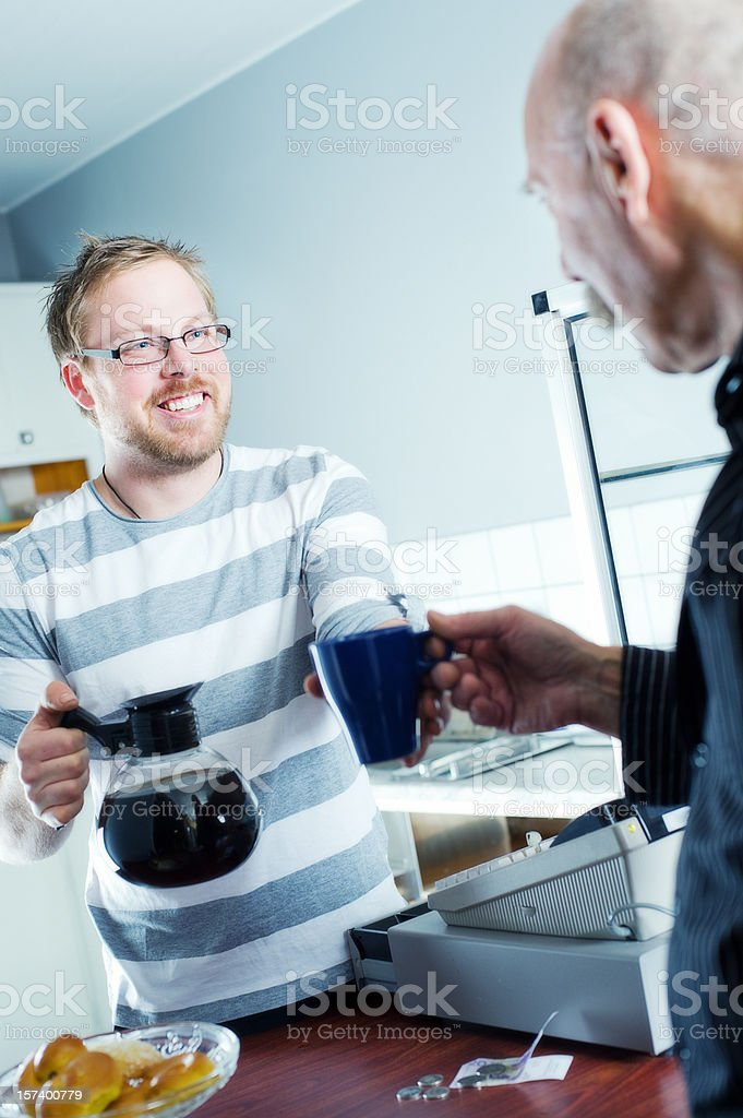 Young man serving a senior royalty-free stock photo