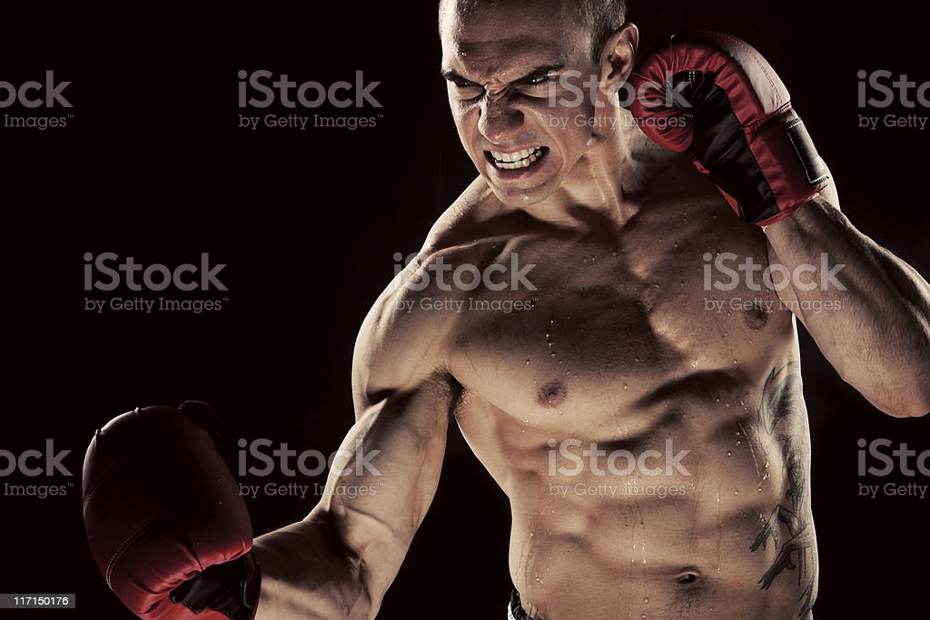 Young Man Shadow Boxing stock photo