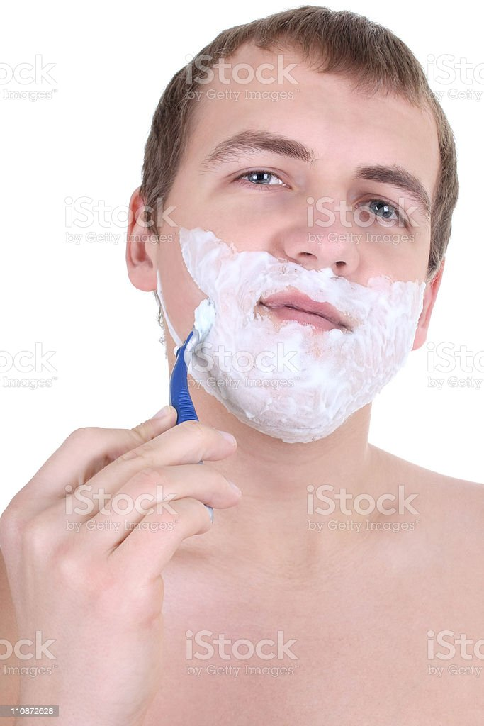 young man shaving with razor royalty-free stock photo