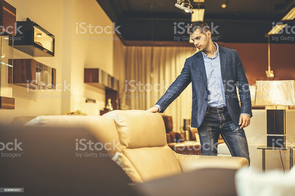 Young man shopping furniture stock photo