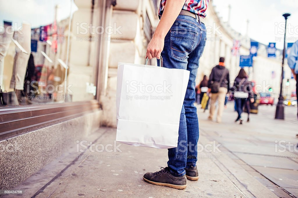 Young man shopping in the city stock photo