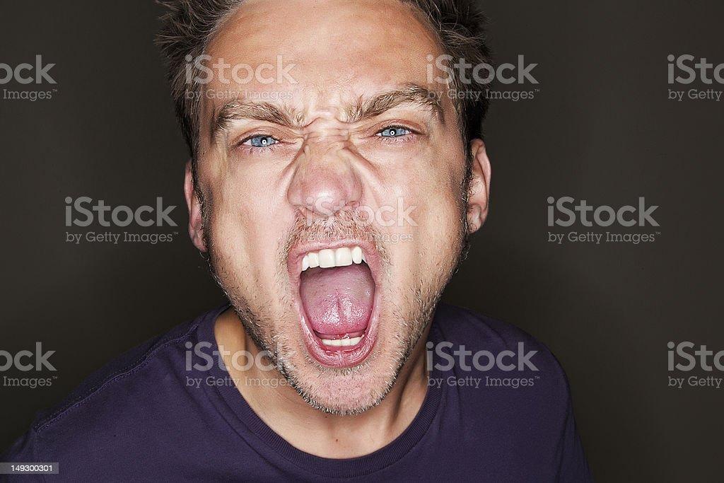 Young man shouting royalty-free stock photo