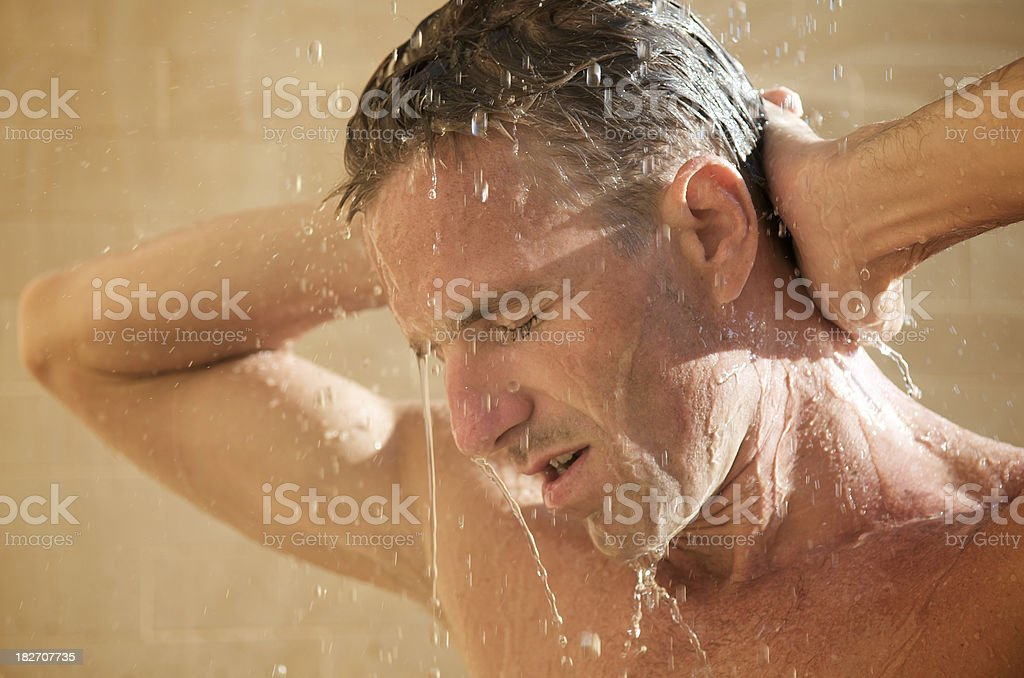 Young Man Showering Outdoors Eyes Closed royalty-free stock photo