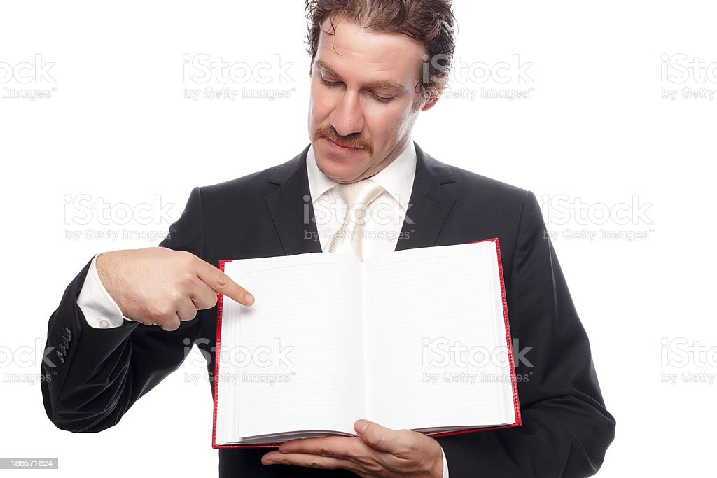 Young man showing blank paper in book royalty-free stock photo