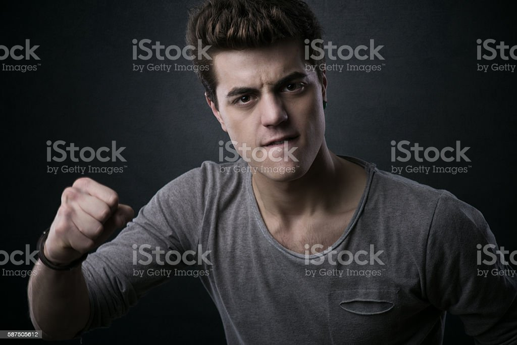 Young man showing fists stock photo
