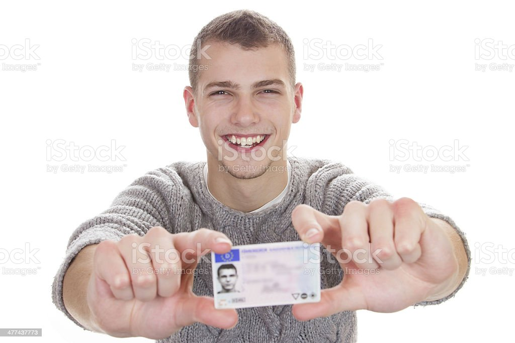 Young man showing his driver license stock photo