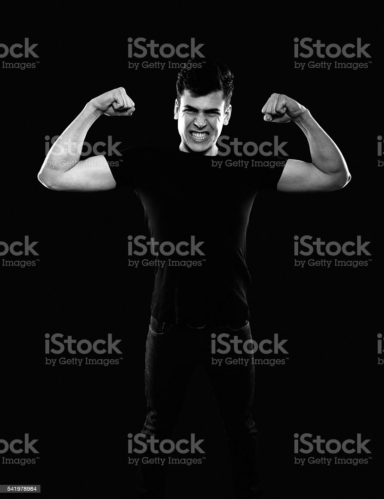 young man showing his muscles stock photo