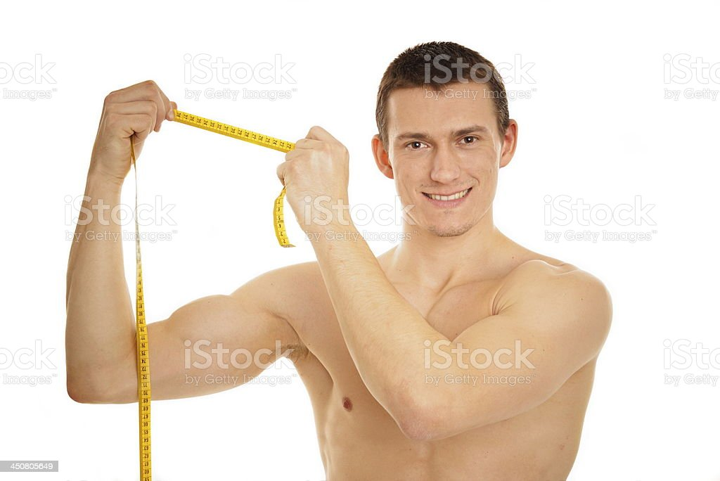 Young man shows a meter. royalty-free stock photo
