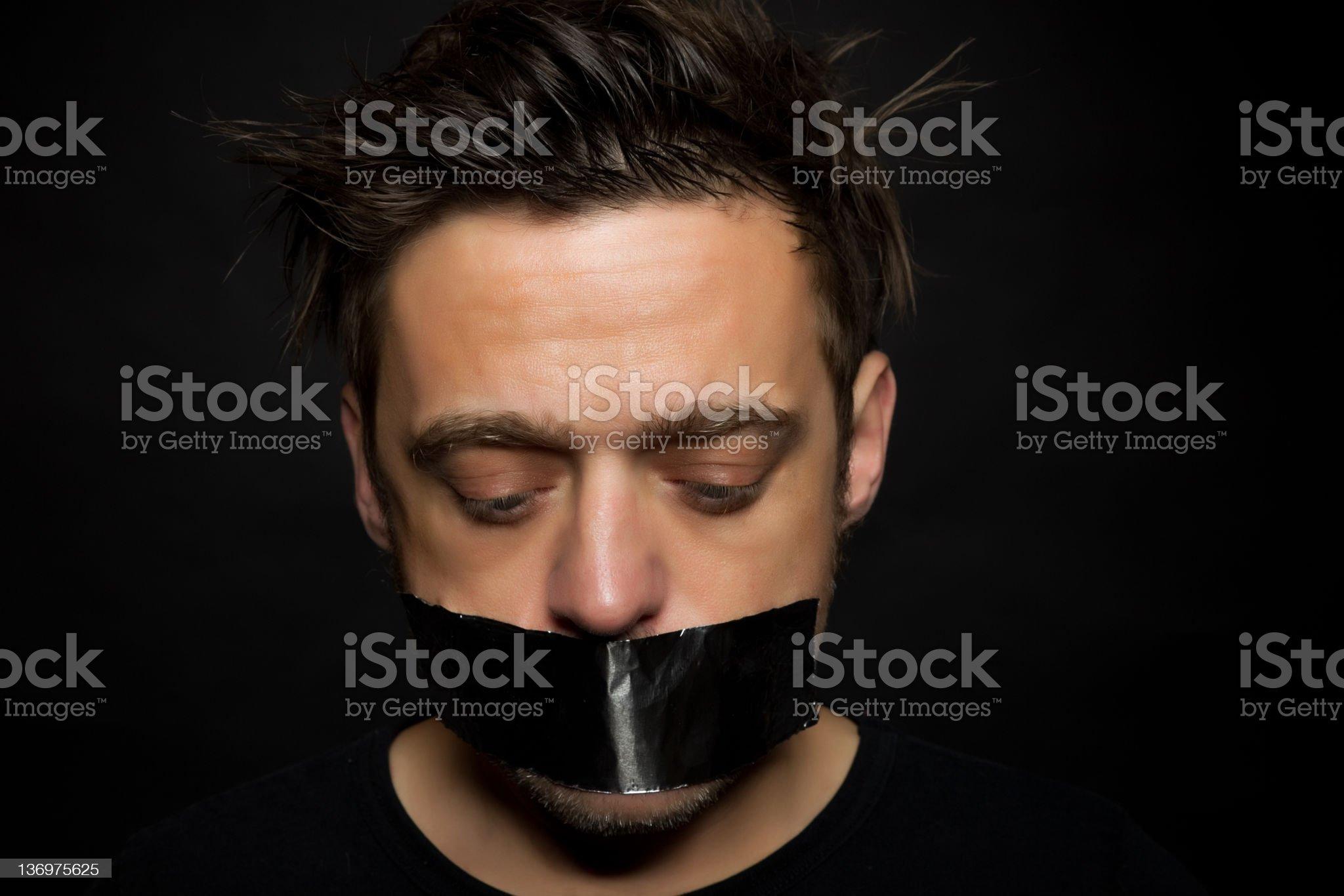 Young man silenced royalty-free stock photo