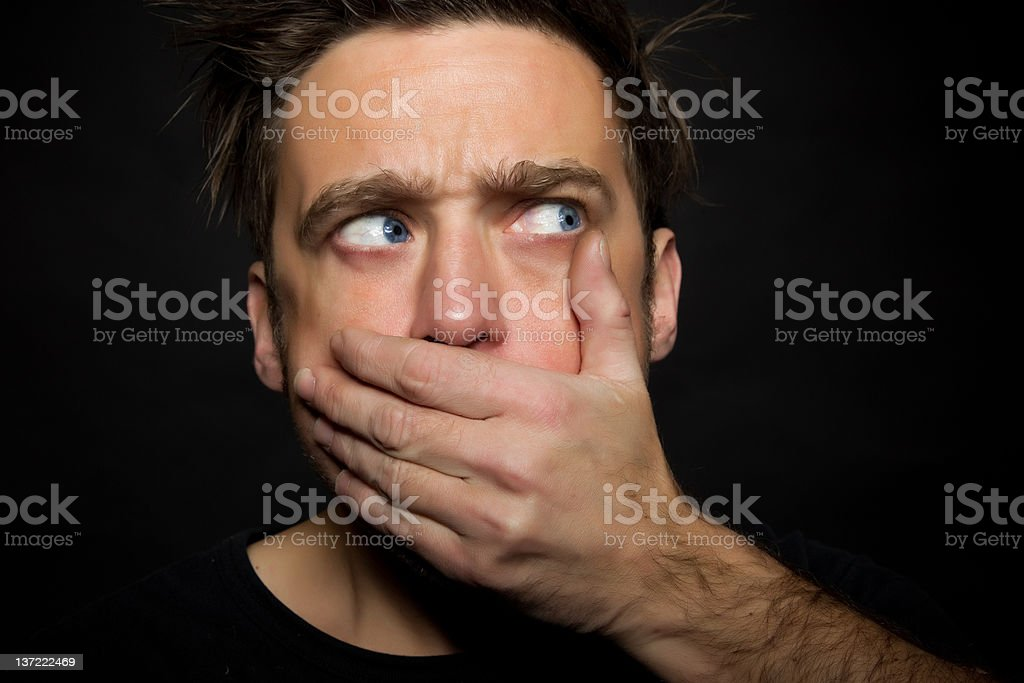 Young man silenced stock photo