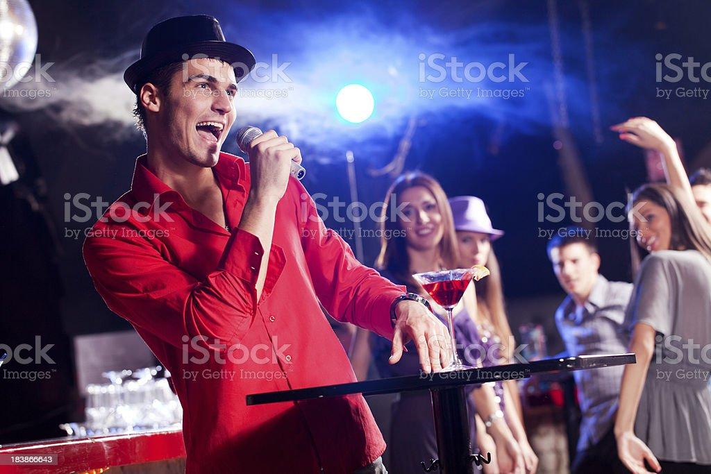 Young man singing at a bar. royalty-free stock photo
