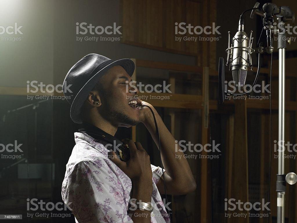 Young man singing stock photo