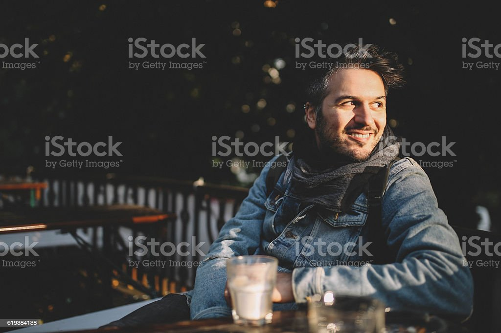 Young man sitting in a cafe in Berlin Prenzlauer Berg stock photo