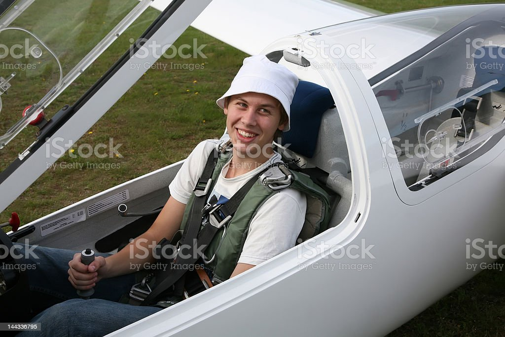 Young man sitting in a glider stock photo
