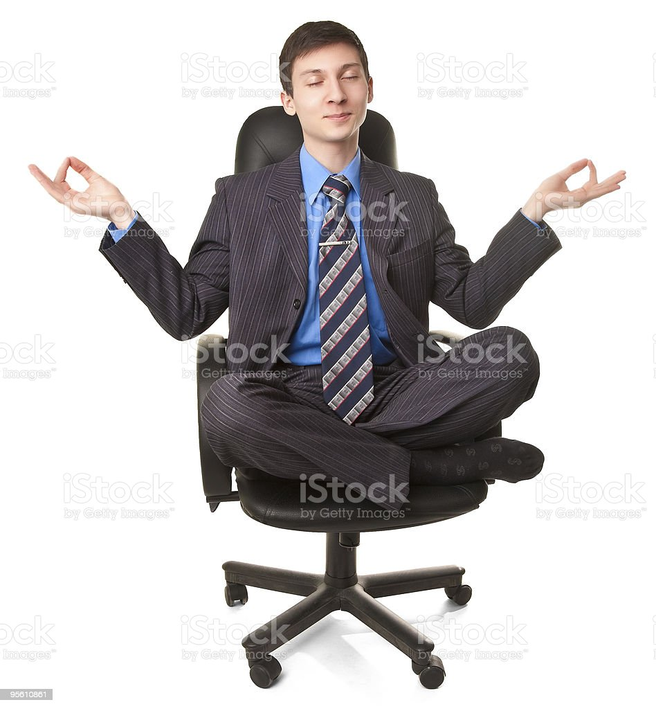 Young man sitting in lotus pose royalty-free stock photo