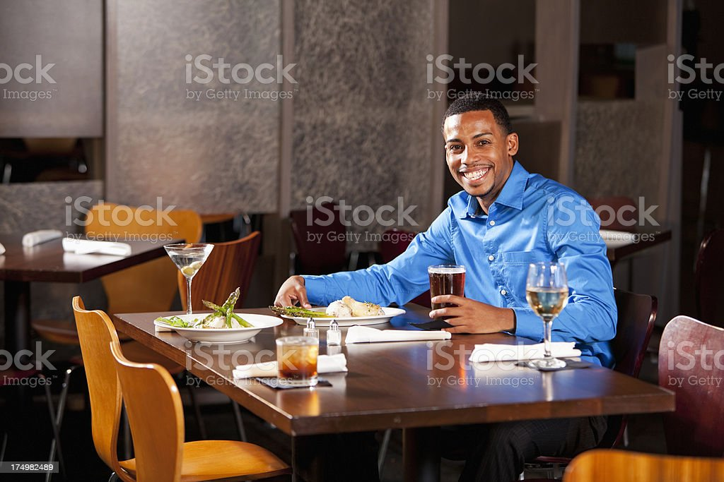 Young man sitting in restaurant stock photo