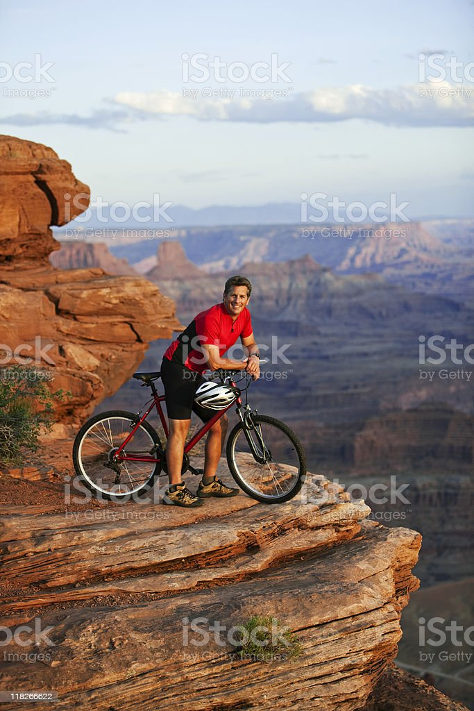 Young Man Sitting On Mountainbike In Canyonlands National Park royalty-free stock photo