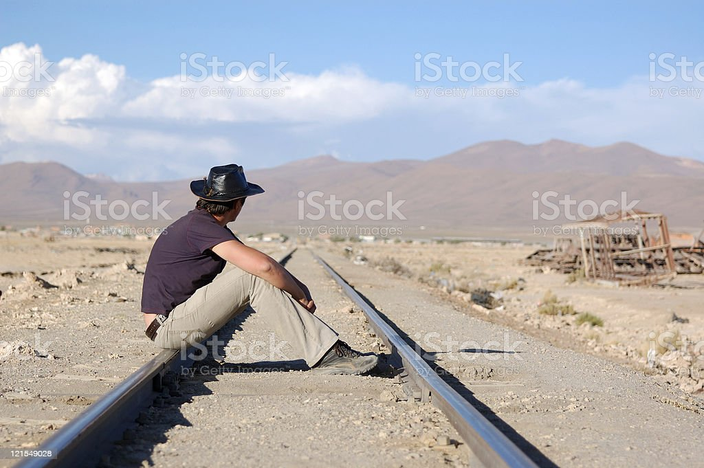 Young man sitting on railways royalty-free stock photo