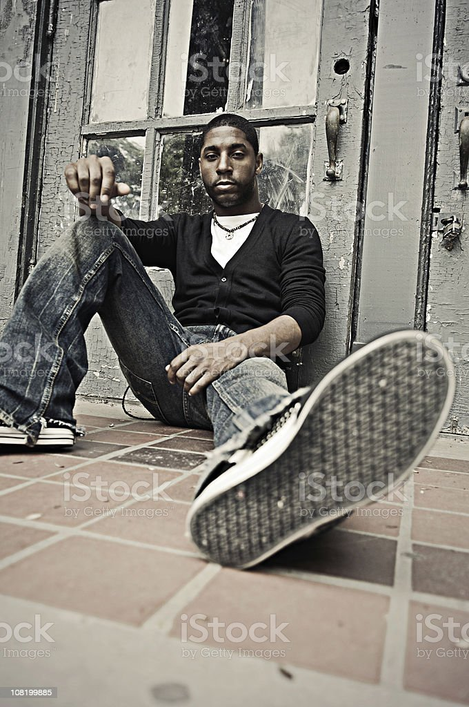 Young man Sitting royalty-free stock photo
