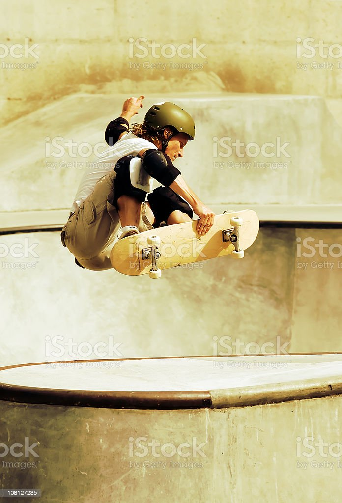 Young Man Skateboarding in Skate Park royalty-free stock photo