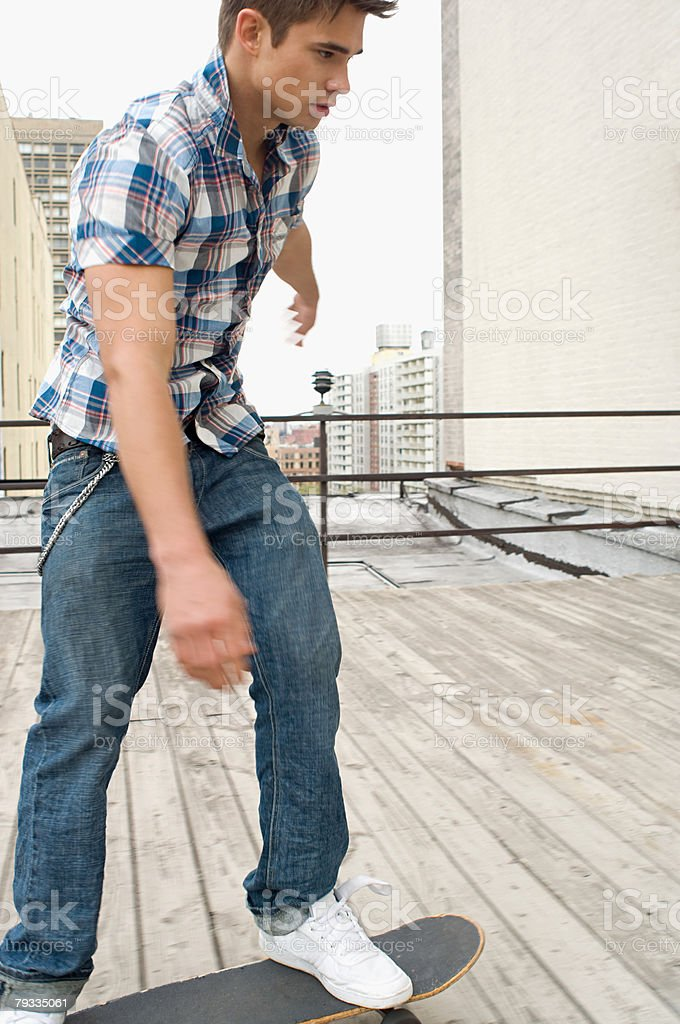 Young man skateboarding stock photo