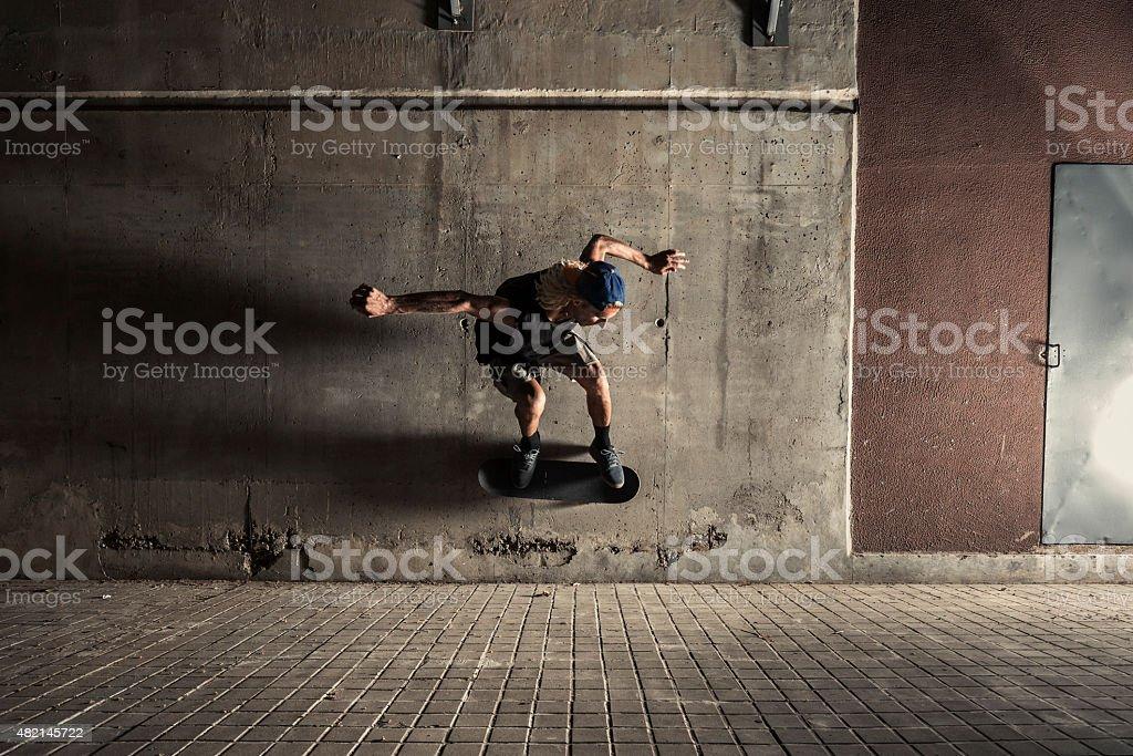 Young man skating in the city at night stock photo