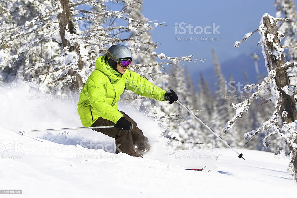 Young man skiing in forest. Freeride royalty-free stock photo