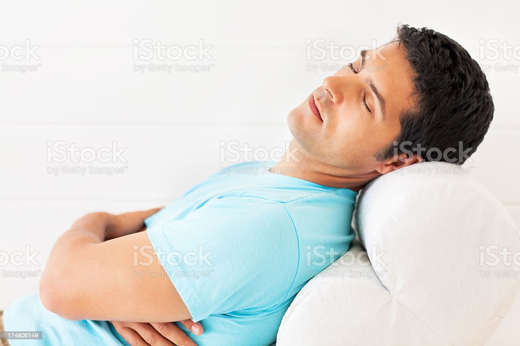 Young Man Sleeping On Sofa royalty-free stock photo