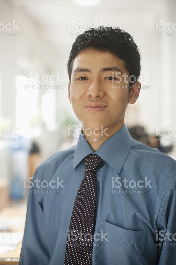 Young man smiling in the office, portrait royalty-free stock photo