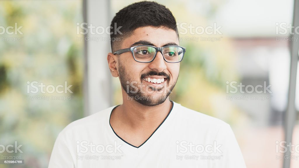 Young man smiling. stock photo